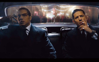 Still of Tom Hardy playing both Kray twins in the film, Legend.