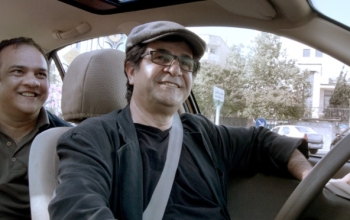 An undated handout picture shows director Jafar Panahi in a still from his film 'Taxi'.