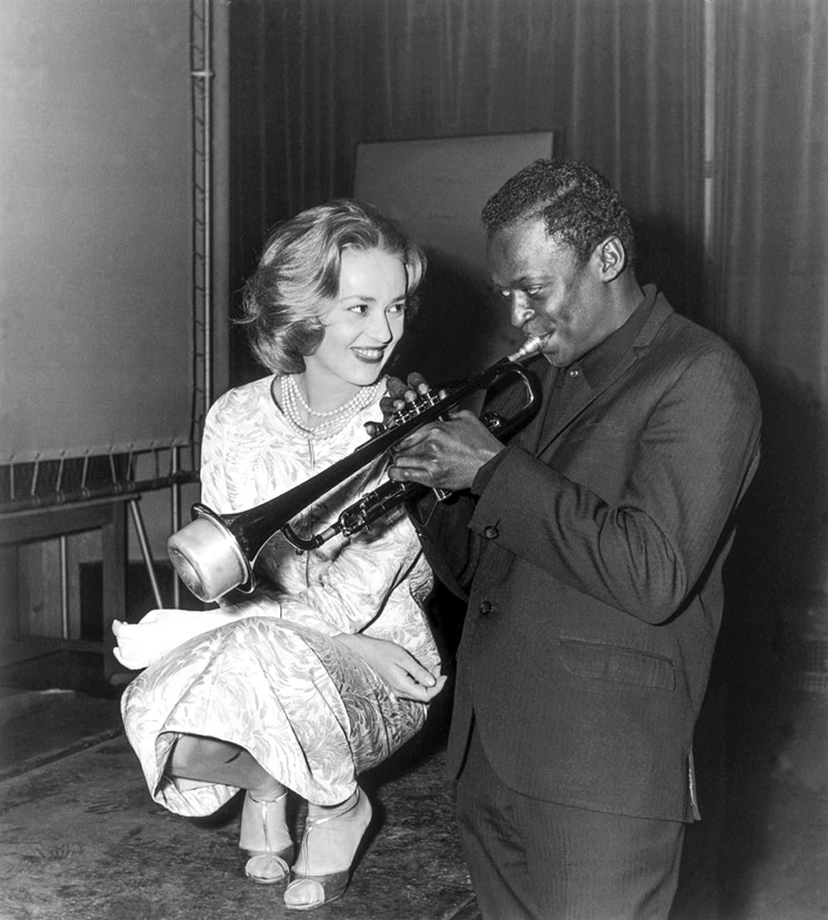 a photo of miles davis and jeanne moreau